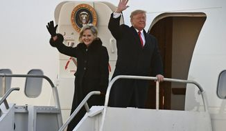 President Donald Trump and Sen. Cindy Hyde-Smith, R-Miss., wave to supporters after arriving for a rally in Tupelo, Miss., Monday, Nov. 26, 2018. (AP Photo/Thomas Graning)
