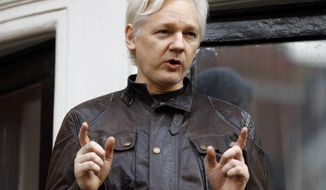 """In this May 19, 2017 file photo, WikiLeaks founder Julian Assange gestures to supporters outside the Ecuadorian embassy in London, where he has been in self imposed exile since 2012. Former Trump campaign chairman Paul Manafort is denying that he ever met WikiLeaks founder Julian Assange. Manafort says in a statement that a Guardian report saying he met with Assange at the Ecuadorian embassy is """"totally false and deliberately libelous."""" Manafort says that he has never been contacted by """"anyone connected to WikiLeaks, either directly or indirectly."""" (AP Photo/Frank Augstein, FILE)"""
