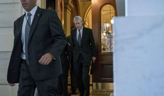 In this June 21, 2017, photo, former FBI Director Robert Mueller, the special counsel probing Russian interference in the 2016 election, departs Capitol Hill following a closed door meeting in Washington. (AP Photo/Andrew Harnik) **FILE**