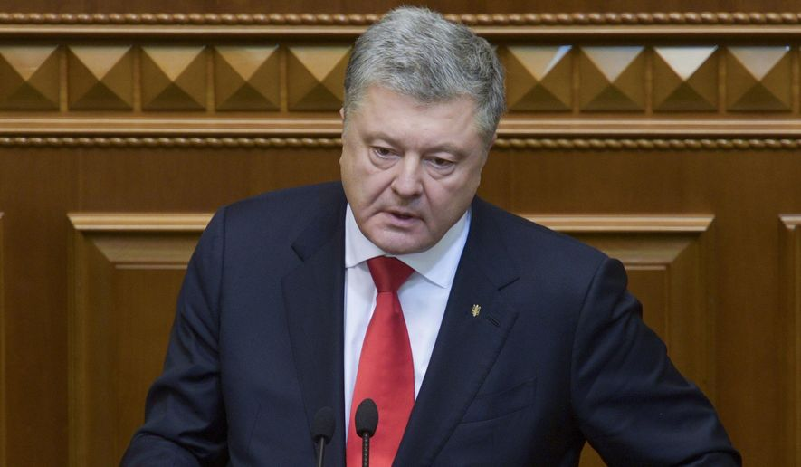 """Ukrainian President Petro Poroshenko gestures during a parliament session in Kiev, Ukraine, Monday, Nov. 26, 2018. Ukraine's president on Monday urged parliament to impose martial law in the country to fight """"growing aggression from Russia,"""" after a weekend naval confrontation off the disputed Crimean Peninsula in which Russia fired on and seized three Ukrainian vessels amid renewed tensions between the neighbors. (Mykola Lazarenko, Presidential Press Service via AP)"""