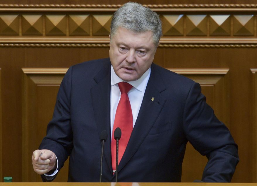 "Ukrainian President Petro Poroshenko gestures during a parliament session in Kiev, Ukraine, Monday, Nov. 26, 2018. Ukraine's president on Monday urged parliament to impose martial law in the country to fight ""growing aggression from Russia,"" after a weekend naval confrontation off the disputed Crimean Peninsula in which Russia fired on and seized three Ukrainian vessels amid renewed tensions between the neighbors. (Mykola Lazarenko, Presidential Press Service via AP)"