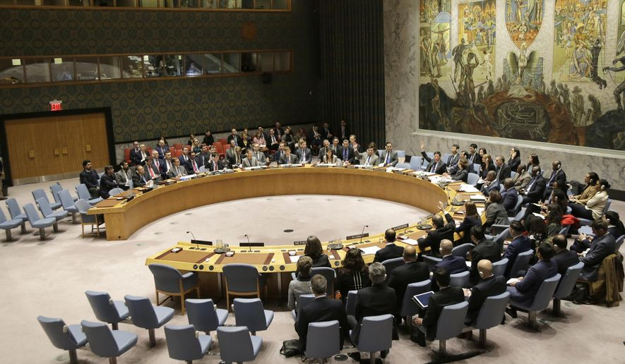 Members of the Security Council vote during a meeting about the escalating tensions between the Ukraine and Russia at United Nations headquarters, Monday, Nov. 26, 2018. Russian border guards opened fire on three Ukrainian vessels in the Kerch Strait near the Russia-occupied Crimean peninsula, raising the prospect of a full-scale military confrontation. The incident comes on the back of a four-and-a-half year long proxy conflict in eastern Ukraine. (AP Photo/Seth Wenig)