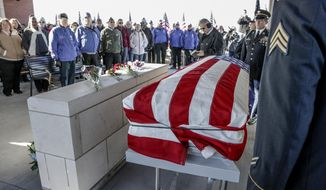 Hundreds attend the funeral services of Vietnam veteran Stanley Stoltz at the Omaha National Cemetery in Omaha, Neb., Tuesday, Nov. 27, 2018. Hundreds volunteered to attend the funeral of Stoltz, who was initially thought to have had no surviving family members. (AP Photo/Nati Harnik)