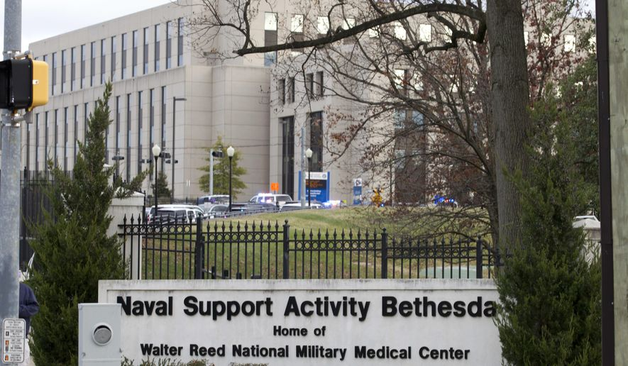 Walter Reed National Military Medical Center is seen on Tuesday, Nov. 27, 2018, in Bethesda Md. The Navy says a drill was taking place at the Maryland base that's home to Walter Reed where an active shooter had been reported. Naval Support Activity Bethesda tweeted that no shooter had been found and personnel could move about the Maryland base freely. (AP Photo/Jose Luis Magana)
