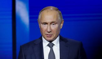 Russian President Vladimir Putin laid blame for the incident in the Kerch Strait on Ukrainian President Petro Poroshenko, saying he orchestrated the provocation to bolster his popularity. (Associated Press)
