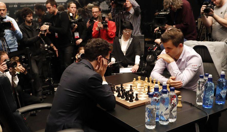 c728c25bb4b1 Carlsen holds off U.S. challenger Caruana to retain world chess ...
