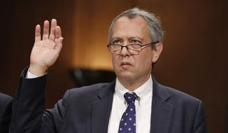 In this Sept. 20, 2017, file photo, Thomas Farr is sworn in during a Senate Judiciary Committee hearing on his nomination to be a District Judge on the United States District Court for the Eastern District of North Carolina, on Capitol Hill in Washington. (AP Photo/Alex Brandon, File)