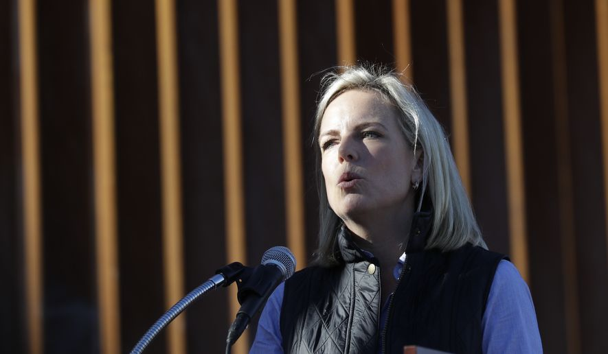 In this Oct. 26, 2018, file photo U.S. Department of Homeland Security Secretary Kirstjen Nielsen speaks in front of a newly fortified border wall structure in Calexico, Calif. (AP Photo/Gregory Bull, File)