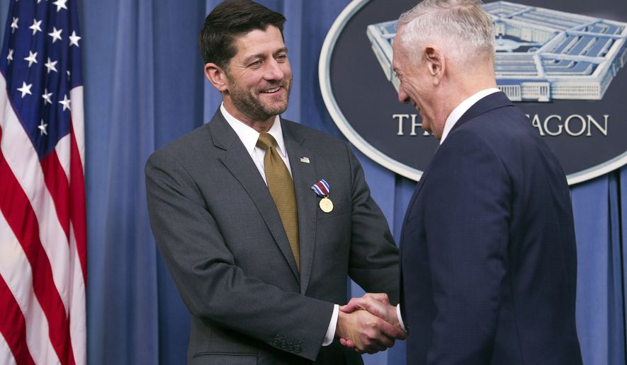 Secretary of Defense Jim Mattis presents Speaker of the House Paul Ryan, of Wis., with the Department of Defense Medal for Distinguished Public Service at the Pentagon, in Washington, Wednesday, Nov. 28, 2018. (AP Photo/Cliff Owen)