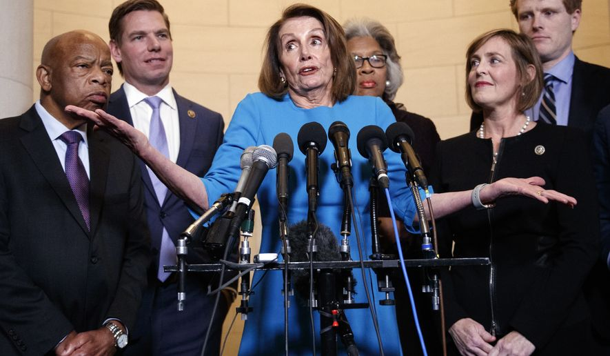 House Minority Leader Nancy Pelosi, D-Calif., joined by from left, Rep. John Lewis, D-Ga., Rep. Eric Swalwell, D-Calif., Rep. Joyce Beatty, D-Ohio., Rep. Kathy Castor, D-Fla., and Rep. Joe Kennedy, D-Mass., gestures as she speaks to media at Longworth House Office Building on Capitol Hill in Washington, Wednesday, Nov. 28, 2018, to announce her nomination by House Democrats to lead them in the new Congress.  (AP Photo/Carolyn Kaster)