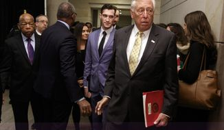 House Minority Whip Steny Hoyer, D-Md., walks from House Democratic leadership elections on Capitol Hill in Washington, Wednesday, Nov. 28, 2018. House Minority Leader Nancy Pelosi, D-Calif., is heading into the House Democratic leadership elections in an unusual position: She's running unopposed. At left is Rep. John Lewis, D-Ga.. (AP Photo/Carolyn Kaster)