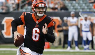 FILE - In this Aug. 30, 2018 file photo Cincinnati Bengals quarterback Jeff Driskel runs the ball during the first half of the team's NFL preseason football game against the Indianapolis Colts in Cincinnati. With quarterback Andy Dalton sidelined for the rest of the season with an injured thumb, Driskel gets the chance to try to pull the Bengals out of their meltdown starting with a home game against the Broncos on Sunday, Dec. 2, 2018. (AP Photo/Frank Victores, file)