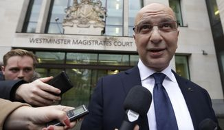 Akin Ipek speaks to media as he leaves Westminster Magistrates Court after his extradition hearing was dismissed in London, Wednesday, Nov. 28, 2018. Akin Ipek is a high-profile critic of President Erdogan of Turkey whose newspapers and TV stations were seized by the Turkish state in 2015. The Turkish Government was seeking the extradition of Mr Ipek, who lives in London and is the director of British company Koza Ltd, and other critics of the Erdogan regime. (AP Photo/Kirsty Wigglesworth)