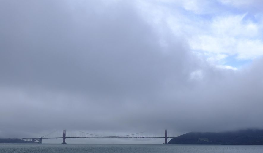 A break in the weather appears over the Golden Gate Bridge Wednesday, Nov. 28, 2018, in San Francisco. Forecasters say California will see widespread rain and heavy Sierra Nevada snowfall starting late Wednesday that could create travel problems and unleash damaging runoff from wildfire burn scars. (AP Photo/Eric Risberg)