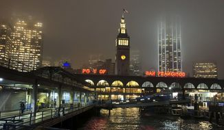 In this photo taken Tuesday, Nov. 27, 2018, rain showers begin to diminish at the Ferry Building in San Francisco. Forecasters say California will see widespread rain and heavy Sierra Nevada snowfall starting late Wednesday that could create travel problems and unleash damaging runoff from wildfire burn scars. (AP Photo/Eric Risberg)