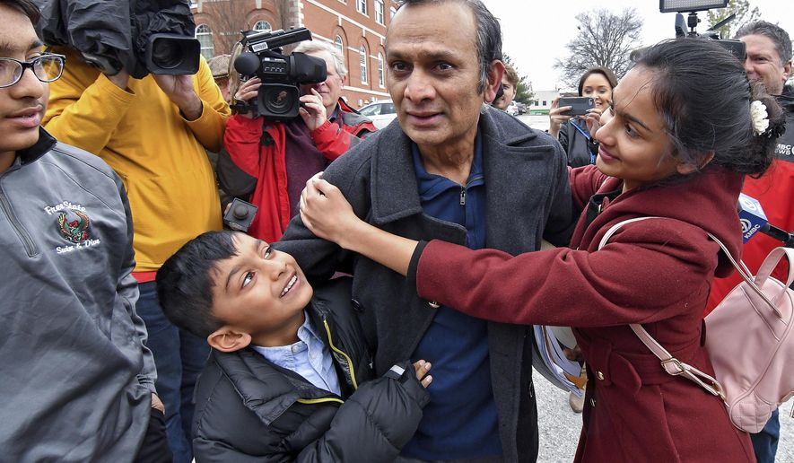 FILE - In this March 20, 2018, file photo, Syed Jamal is surround by his children, from left, Taseen Jamal, 14, Fareed Jamal, 7, and Naheen Jamal, 12, after he was released from the Platte County jail in Platte City, Kan., following a federal judge's order, pending the outcome of his deportation case. The case against Jamal, who is fighting deportation to his native Bangladesh will go on until at least 2022. A judge set the next hearing in the case for April 27, 2022. (John Sleezer/The Kansas City Star via AP, File)