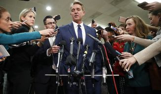 Sen. Jeff Flake, R-Ariz., speaks to members of the media after leaving a closed door meeting about Saudi Arabia with Secretary of State Mike Pompeo, Wednesday, Nov. 28, 2018, on Capitol Hill in Washington. (AP Photo/Pablo Martinez Monsivais)