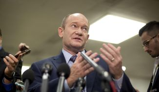 Sen. Chris Coons, D-Del., gestures while speaking to members of the media after leaving a closed-door meeting about Saudi Arabia, Wednesday, Nov. 28, 2018, on Capitol Hill in Washington.  (AP Photo/Pablo Martinez Monsivais) ** FILE **