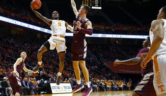 Tennessee guard Jordan Bone (0) shoots over Eastern Kentucky forward Lachlan Anderson (21) during the first half of an NCAA college basketball game Wednesday, Nov. 28, 2018, in Knoxville, Tenn. (AP photo/Wade Payne)