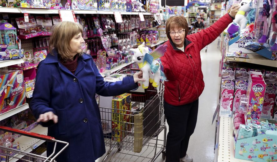 Kaye Frohmader, left, Maple Bluff and her sister Barb Schutz, Waunakee ship for toys the the Farm & Fleet in Verona, Wis. This year Black Friday could be one stop shopping. With the demise of Toys R Us retailers are devoting more space to toys. (Steve Apps/Wisconsin State Journal via AP)