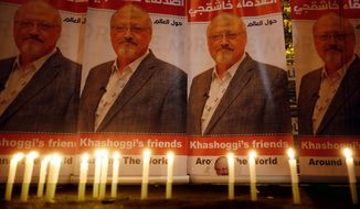 In this Oct. 25, 2018, file photo, candles lit by activists protesting the killing of Saudi journalist Jamal Khashoggi are placed outside Saudi Arabia's Consulate in Istanbul.  (AP Photo/Lefteris Pitarakis, File) **FILE**