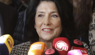 Salome Zurabishvili, former Georgian Foreign minister and presidential candidate, speaks to the media outside a polling station in Tbilisi, Georgia, Wednesday, Nov. 28, 2018. Two of Georgia's former foreign ministers are facing off against each other Wednesday in a tight runoff that will mark the last time Georgians elect their head of state by popular vote. Georgia, a nation of nearly 4 million people in the volatile Caucasus region south of Russia, is transitioning to a parliamentary republic. (AP Photo/Shakh Aivazov)