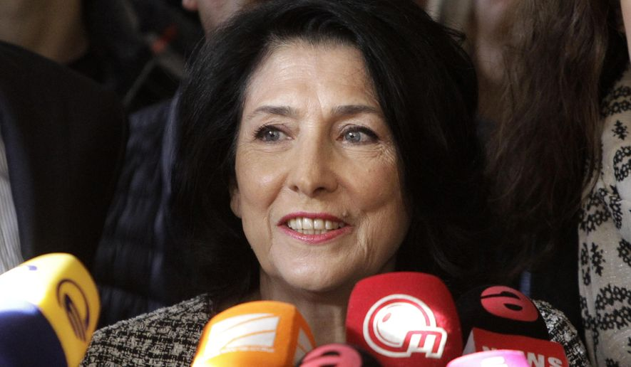 Salome Zurabishvili, former Georgian Foreign minister and presidential candidate, speaks to the media at her campaign headquarter in Tbilisi, Georgia, Wednesday, Nov. 28, 2018.  the French-born former foreign minister of Georgia Zurabishvili celebrated what she claims is her victory in a tight presidential runoff Wednesday that marks the last time Georgians elect their head of state by popular vote. (AP Photo/Shakh Aivazov)