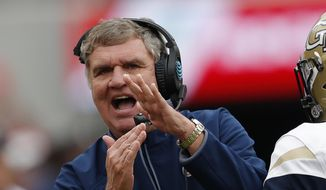 Georgia Tech head coach Paul Johnson calls for a timeout during the second half of an NCAA college football game against Georgia, Saturday, Nov. 24, 2018, in Athens, Ga. Georgia won 45-21. (AP Photo/John Bazemore) **FILE**