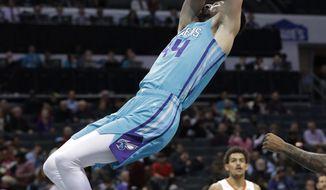 Charlotte Hornets' Frank Kaminsky dunks against the Atlanta Hawks during the first half of an NBA basketball game in Charlotte, N.C., Wednesday, Nov. 28, 2018. (AP Photo/Chuck Burton)