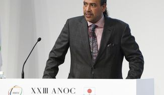 Sheikh Ahmad al Fahad al Sabah, president of the Association of National Olympic Committees (ANOC) delivers a speech during the ANOC general assembly in Tokyo Wednesday, Nov. 28, 2018. The ANOC general assembly opened on Wednesday, overshadowed by a corruption case involving its powerful president, the sheikh. (AP Photo/Eugene Hoshiko)