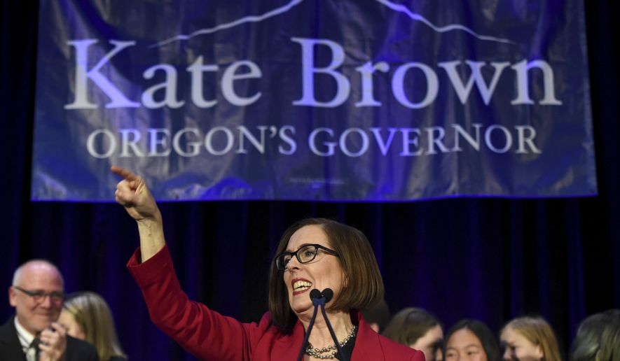 FILE - In this Nov. 6, 2018, file photo, Gov. Kate Brown addresses the crowd after winning re-election in Portland, Ore. Brown unveiled a $23.6 budget proposal for the next biennium on Wednesday, saying she wants to boost education funding, push campaign finance reform, ensure continued access to health insurance coverage and fund legal counseling for immigrants facing deportation. (AP Photo/Steve Dykes, File)