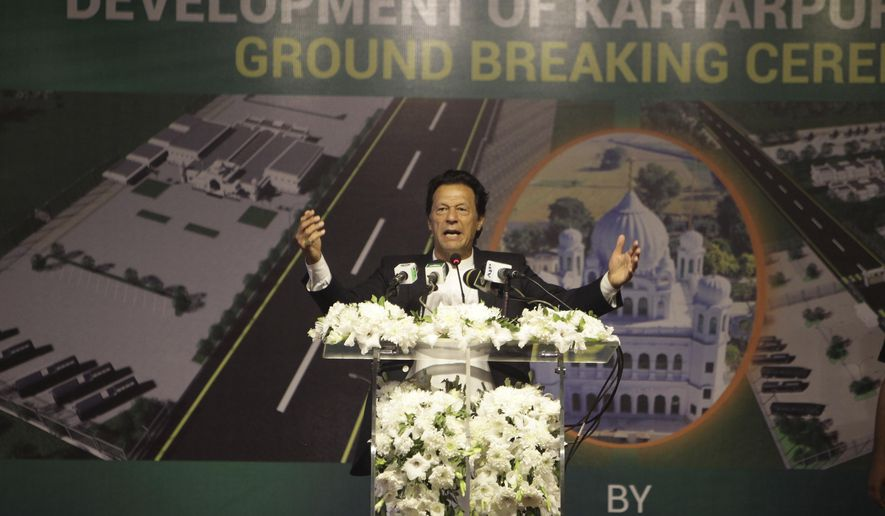 Pakistani Prime Minister Imran Khan addresses during a ceremony in Kartarpur, Pakistan, Wednesday, Nov. 28, 2018. Khan attended the groundbreaking ceremony for the first visa-free border crossing with India, a corridor that will allow Sikh pilgrims to easily visit their shrines on each side of the border. The crossing, known as the Kartarpur corridor is a rare sign of cooperation between the two nuclear-armed rival countries.(AP Photo/K.M. Chaudary)