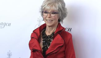 """FILE - In this Aug. 25, 2018, file photo, Rita Moreno arrives at the 33rd annual Imagen Awards at the JW Marriott L.A. Live in Los Angeles. Moreno's portrayal of italieAnita won her an Oscar for the 1961 film version of """"West Side Story,"""" and now she has a part in a remake directed by Steven Spielberg. (Photo by Richard Shotwell/Invision/AP, File)"""
