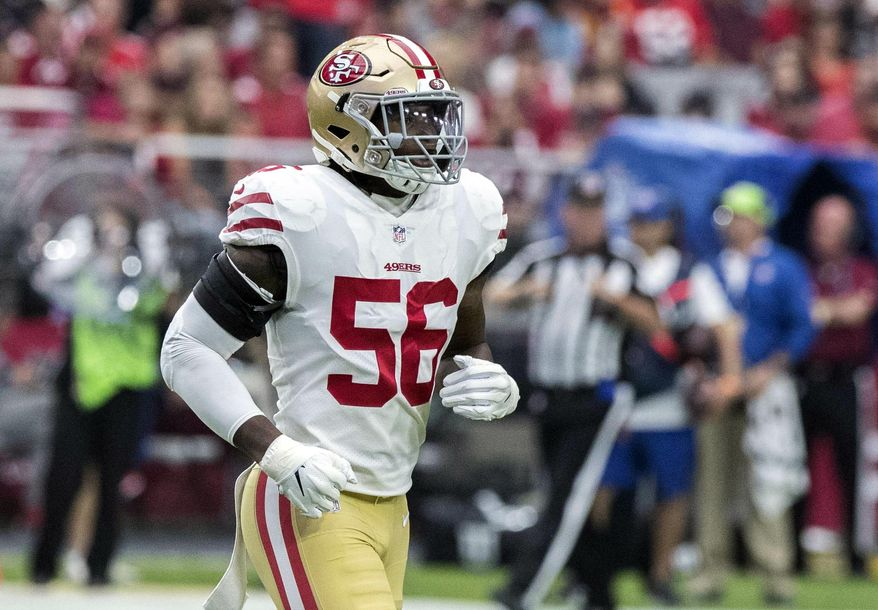 FILE - In this Oct. 28, 2018, file photo, San Francisco 49ers' Reuben Foster (56) jogs on the field during the first half of an NFL football game against the Arizona Cardinals in Glendale, Ariz. The Washington Redskins claimed Foster off waivers on Tuesday, Nov. 27, 2018, after the 49ers released the linebacker following a domestic violence arrest. The team says conversations with former Alabama teammates led to the decision to claim Foster. (AP Photo/Darryl Webb, File) **FILE**