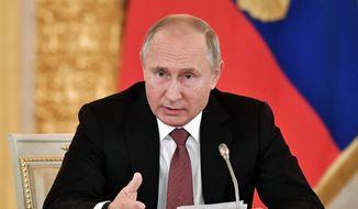 Russian President Vladimir Putin speaks during a meeting in Moscow's Kremlin, Russia, Tuesday, Nov. 27, 2018. (Alexei Nikolsky, Sputnik, Kremlin Pool Photo via AP)