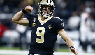 FILE - In this Nov. 22, 2018, file photo, New Orleans Saints quarterback Drew Brees reacts after throwing a touchdown pass during the first half of the team's NFL football game against the Atlanta Falcons in New Orleans. The record-setting quarterback will go for an 11th straight win after a season-opening loss, when the Saints visit the Dallas Cowboys on Thursday night. (AP Photo/Butch Dill, File)