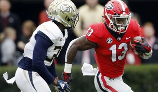 FILE - In this Saturday, Nov. 24, 2018, file photo, Georgia tailback Elijah Holyfield (13) drives past Georgia Tech defensive back Ajani Kerr (38) during the first half of an NCAA college football game in Athens Ga. No. 1 Alabama's typically tough defense will be challenged by No. 4 Georgia's offense that enters Saturday's SEC championship game on a roll. (Joshua L. Jones/Athens Banner-Herald via AP, FIle) **FILEu7