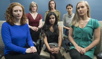 FILE - In this Nov. 14, 2018 file photo, from left back row, Annemarie Brown, Andrea Courtney, and Marissa Evansin, and from left front row, Sasha Brietzke, Vassiki Chauhan, Kristina Rapuano, pose in New York. The women filed a lawsuit against Dartmouth College for allegedly allowing three professors to create a culture in their department that encouraged drunken parties and subjected female graduate students to harassment, groping and sexual assault. A growing number of former students are demanding answers from the administration and questioning how such an atmosphere apparently flourished for at least 15 years at the Ivy League school in Hanover, N.H. (AP Photo/Mary Altaffer, File)