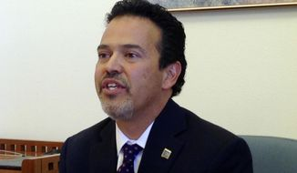 FILE - In this May 14, 2014 file photo, New Mexico Democratic state Rep. Carl Trujillo, a Santa Fe Democrat, announces a lawsuit filed in the state Supreme Court in Santa Fe, N.M. A long-awaited public hearing on sexual harassment accusations against the New Mexico state lawmaker has been canceled after the accuser decided not to testify. A House subcommittee announced Wednesday, Nov. 28, 2018 the dismissal of charges against Trujillo. (AP Photo/Barry Massey, File)
