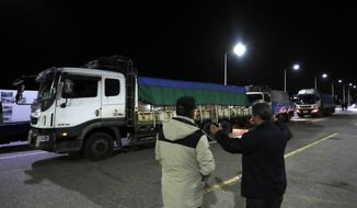 Trucks carrying insecticide wait to leave for North Korea at the Unification Bridge, in Paju, South Korea, Thursday, Nov. 29, 2018. South Korea has sent about 50 tons of insecticide to North Korea to help stop a pine tree disease from spreading. (AP Photo/Lee Jin-man)