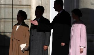 Chinese President Xi Jinping, second left, poses with Spain's King Felipe, second from right, together with their wives Peng Liyuan, left, and Spain's Queen Letizia during a welcome ceremony at the Royal Palace in Madrid, Spain, Wednesday, Nov. 28, 2018. Chinese president Xi Jinping has arrived Tuesday in Spain for the first leg of an international tour that will cover a global summit in Argentina and visits to Panama and Portugal. (AP Photo/Manu Fernandez)