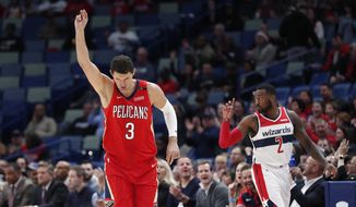 New Orleans Pelicans forward Nikola Mirotic (3) reacts after sinking a 3-point basket in the first half of an NBA basketball game against the Washington Wizards in New Orleans, Wednesday, Nov. 28, 2018. (AP Photo/Gerald Herbert)