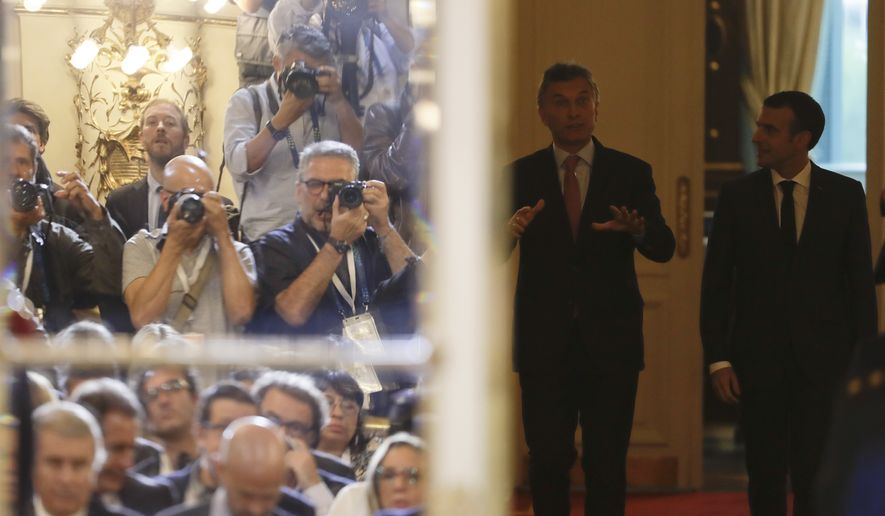 France's President Emmanuel Macron, right, and Argentina's President Mauricio Macri arrive for a press conference at the presidential palace in Buenos Aires, Argentina, Thursday, Nov. 29, 2018. Macron is in Buenos Aires to attend the two-day summit of leaders from the Group of 20 industrialized nations starting Friday. (AP Photo/Natacha Pisarenko)