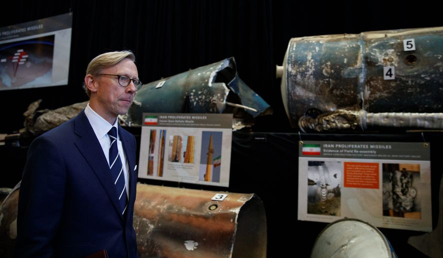 "Brian Hook, U.S. special representative for Iran, walks past fragments of Iranian short range ballistic missiles (Qiam) at the Iranian Materiel Display (IMD) at Joint Base Anacostia-Bolling, in Washington, Thursday Nov. 29, 2018. The Trump administration accused Iran of stepping up violations of a U.N. ban on arms exports by sending rockets and other weaponry to rebels in Afghanistan and Yemen. The presentation displays weapons and fragments of weapons seized in Afghanistan, Bahrain and Yemen that it said are evidence Iran is a ""grave and escalating threat"" that must be stopped.  (AP Photo/Carolyn Kaster)"