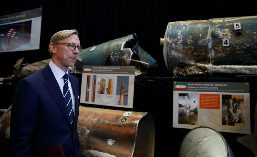"""Brian Hook, U.S. special representative for Iran, walks past fragments of Iranian short range ballistic missiles (Qiam) at the Iranian Materiel Display (IMD) at Joint Base Anacostia-Bolling, in Washington, Thursday Nov. 29, 2018. The Trump administration accused Iran of stepping up violations of a U.N. ban on arms exports by sending rockets and other weaponry to rebels in Afghanistan and Yemen. The presentation displays weapons and fragments of weapons seized in Afghanistan, Bahrain and Yemen that it said are evidence Iran is a """"grave and escalating threat"""" that must be stopped.  (AP Photo/Carolyn Kaster)"""