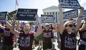 In this June 25, 2018, photo, pro-life and anti-abortion advocates demonstrate in front of the Supreme Court. (Associated Press) **FILE**
