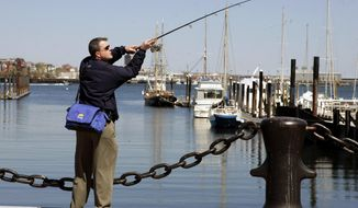 FILE- In this April 26, 2006 file photo, John Kelly Jr. fishes for striped bass in Boston Harbor. A canary in a coal mine? How about a flounder in a harbor? Offering a rare bit of good environmental news, scientists have documented a dramatic rebound in fish health they say shows how once horribly polluted Boston Harbor has cleaned up its act. (AP Photo/Elise Amendola, File)