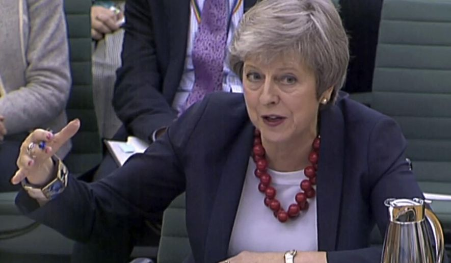 Prime Minister Theresa May gives evidence before the Liaison Committee on matters relating to Brexit at Portcullis House in London, Thursday, Nov. 29, 2018. The governor of the Bank of England Mark Carney says most British businesses aren't ready for a no-deal departure from the European Union as lawmakers from all parties are criticising the agreement Prime Minister May negotiated with the EU, increasing the likelihood of a no-deal Brexit.  (PA via AP)