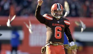 FILE -In this Sunday, Nov. 11, 2018, file photo, Cleveland Browns quarterback Baker Mayfield (6) celebrates a touchdown in the second quarter of a 28-16 win over the Atlanta Falcons in an NFL football game in Cleveland. Mayfield had a November to remember, completing 74 percent of his passes while leading the Browns (4-6-1) to two wins and the edge of playoff possibilities. (AP Photo/David Richard, File)