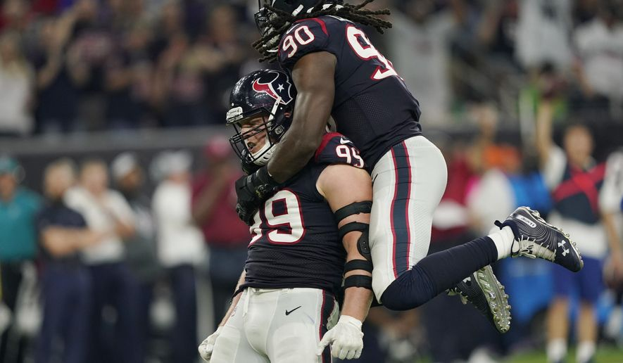 FILE- In this Oct. 7, 2018, file photo Houston Texans defensive end J.J. Watt (99) and linebacker Jadeveon Clowney (90) celebrate a stop against the Dallas Cowboys during the second half of an NFL football game in Houston. The Cleveland Browns have done a great job of protecting Baker Mayfield recently, and haven't allowed a sack in 125 snaps, the longest active streak in the NFL. Things will get more difficult for the Browns (4-6-1) on Sunday, Dec. 2, 2018 when they visit the Texans (8-3) and their defense led by Watt and Clowney. Watt is tied for second in the NFL with 11 1/2 sacks and Clowney has seven. (AP Photo/David J. Phillip, File)